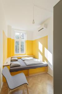 A bed or beds in a room at Flow Hostel