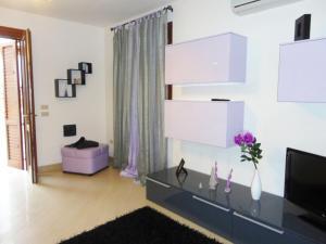 TV o dispositivi per l'intrattenimento presso Casa vacanze Loredana