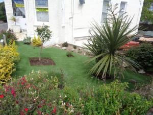A garden outside The Charlesworth