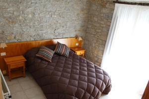 Llit o llits en una habitació de Hotel D'Ares