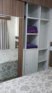 A bed or beds in a room at Via Caldas L'acqua I