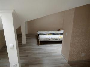 Кровать или кровати в номере 2-х этажная студия