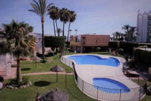 A view of the pool at Río Marinas de Nerja or nearby