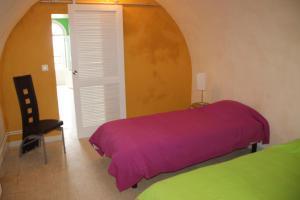 Un ou plusieurs lits dans un hébergement de l'établissement Villa Normande