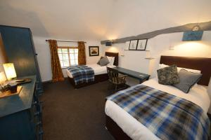 A bed or beds in a room at The White Lion Inn