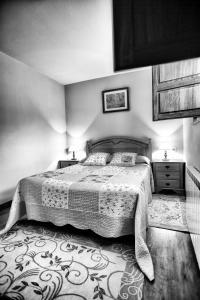 Cama o camas de una habitación en Apartamentos Rio Tabardin