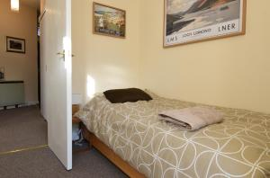 A bed or beds in a room at Mansfield Apartment