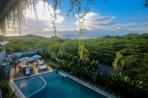 The swimming pool at or near Padang-Padang Inn