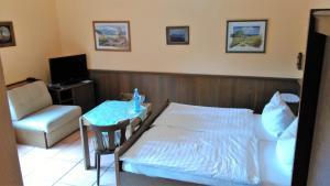 Ein Bett oder Betten in einem Zimmer der Unterkunft Landhaus im kühlen Grunde Garni
