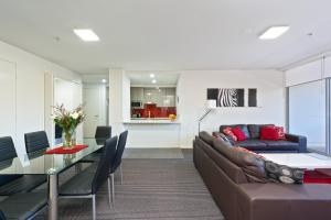 A seating area at Astra Apartments North Sydney