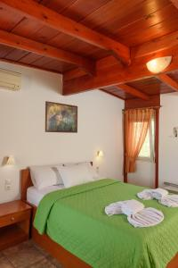 A bed or beds in a room at Nikos Hotel