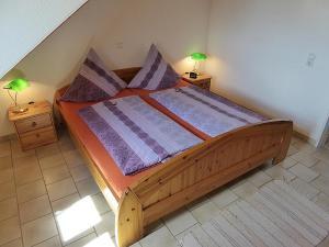 Ein Bett oder Betten in einem Zimmer der Unterkunft Haus Sonntag