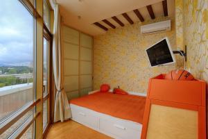 Кровать или кровати в номере Апартаменты с террасой в ЖК Версаль