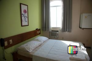 A bed or beds in a room at Hotel Porto Da Barra