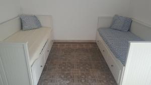 A bed or beds in a room at OYO Guest House Ruzafa