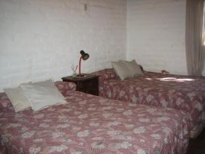 A bed or beds in a room at Cabanas Sucot