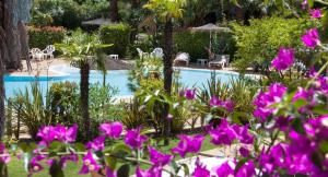 A view of the pool at Hôtel Le Cottage or nearby
