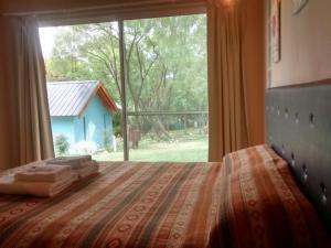 Una cama o camas en una habitación de Flor de Lis Casas de Campo