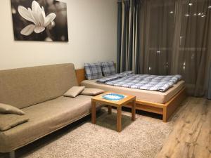Гостиная зона в Апартаменты на ул.Кременчугская, д.11,к.2