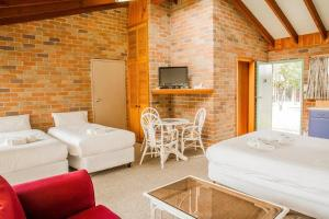 A bed or beds in a room at Crescent Head Resort & Conference Centre