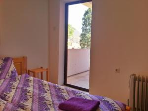 A bed or beds in a room at Guest House Zora