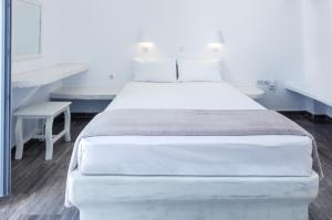 A bed or beds in a room at Selini Ηotel