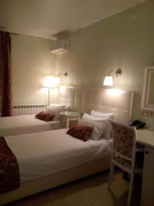 Ein Bett oder Betten in einem Zimmer der Unterkunft Avantazh Hotel