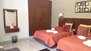 A bed or beds in a room at Hotel Aaktun Kay