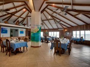 A restaurant or other place to eat at Coco Plum All Inclusive Resort