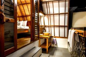 A bunk bed or bunk beds in a room at Manta Dive Gili Trawangan Resort