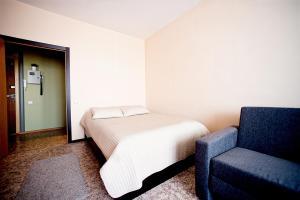 Кровать или кровати в номере Апартаменты КакДома