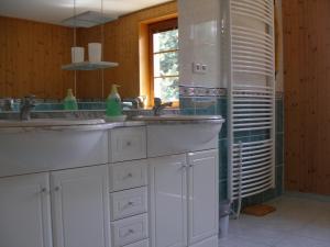A kitchen or kitchenette at Apartmány Arnika