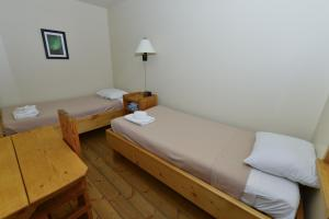 A bed or beds in a room at The Bunkhouse