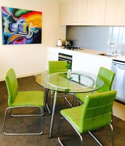 A kitchen or kitchenette at Newcastle Beach Apartment
