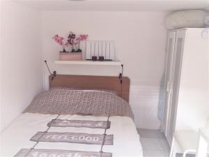 Een bed of bedden in een kamer bij Appartement Alicja