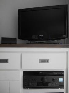 A television and/or entertainment center at Ti Boug