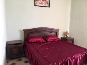 A bed or beds in a room at Artika Hotel