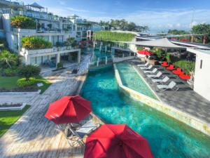 A view of the pool at FuramaXclusive Ocean Beach Seminyak Bali or nearby