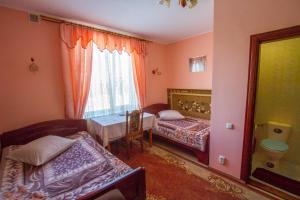 A bed or beds in a room at Orysya