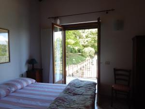 Säng eller sängar i ett rum på I Lecci