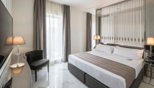 A bed or beds in a room at Hotel Balneari Termes Orion
