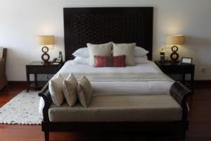 A bed or beds in a room at Jaypee Greens Golf and Spa Resort