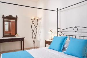 A bed or beds in a room at Terra Blue Santorini