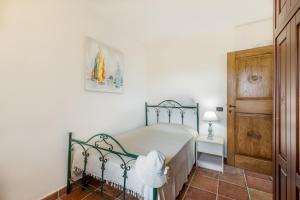 A bed or beds in a room at Villa Mediterraneo