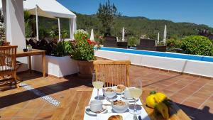 The swimming pool at or near Hotel Rural Can Maries