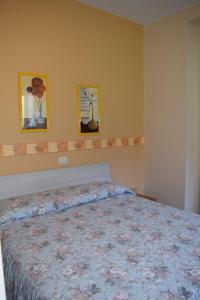 Ein Bett oder Betten in einem Zimmer der Unterkunft Albergo De Jean