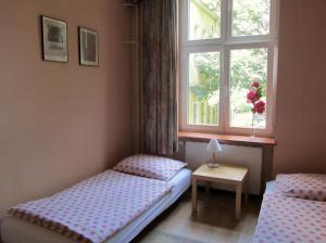 Łóżko lub łóżka w pokoju w obiekcie Apartament Ogarna