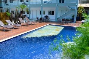 The swimming pool at or close to Hotel Bertell Inn
