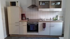 Küche/Küchenzeile in der Unterkunft Ferienwohnung Parkblick