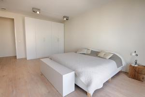 A bed or beds in a room at NTH Apartments
